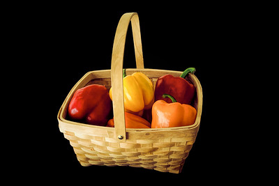 Isolated Colored Sweet Peppers in a Basket
