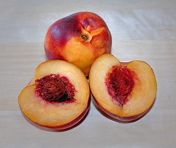 One sliced & one whole ripe nectarines