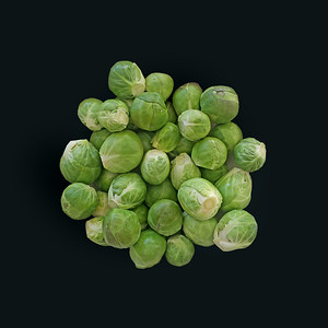 fresh, raw, green brussels sprouts on black background