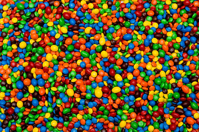 """Imposter #1""      There is one Skittle hiding amongst this mess of M&M's.  Can you find it?  The ""S"" is in plain view.  Good luck!"