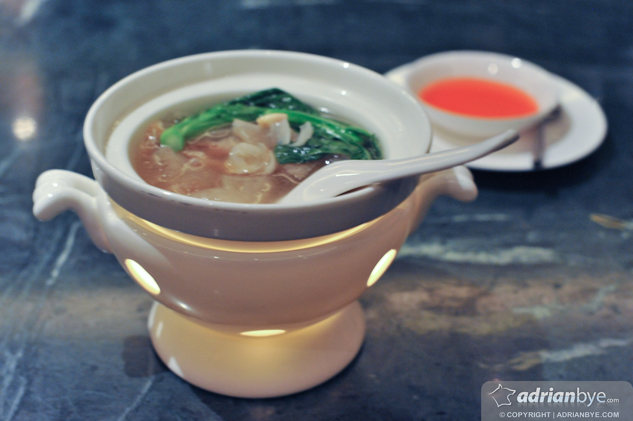 FIsh maw and shark's fin chicken stock served with fresh lily bulbs