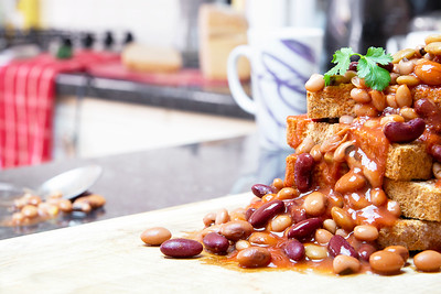 A Fully Loaded Stack of Beans on Toast in a Kitchen and Ready to Eat