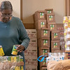 Catholic Charities of Worcester County in Leomisnter had a stocked food pantry on Monday, March 16, 2020. Melanie Kuykendoll with Catholic Charities stocks their shelves on Monday. They are filling bags up with food for families ahead of time so that when they show up they spend less time there to help with the social distancing.  SENTINEL & ENTERPRISE/JOHN LOVE