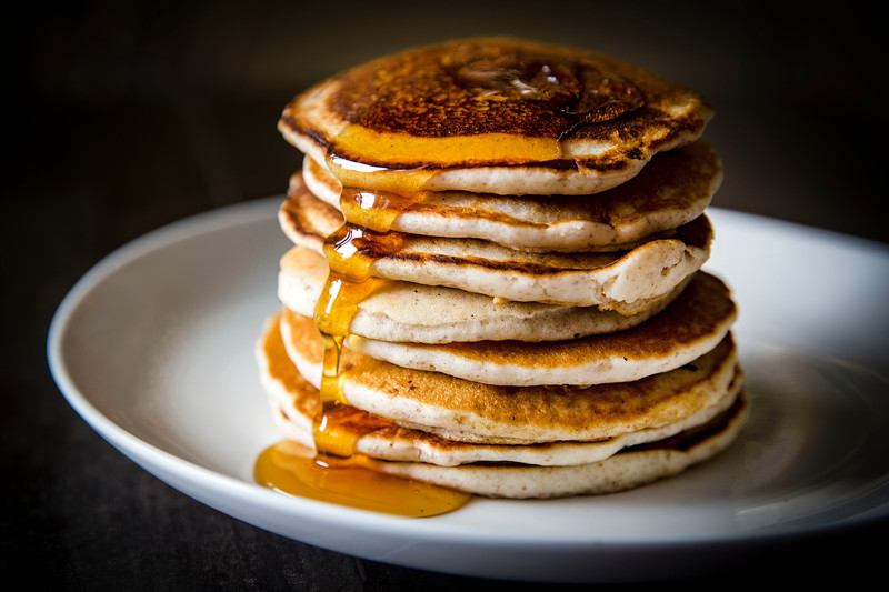 Stack of Golden Brown Pancakes with Syrup