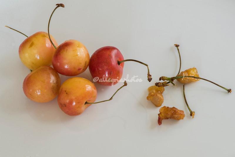 Yellow cherries and pits