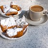 Two plates of beignets and a cup of cafe au lait, New Orleans