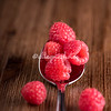 Raspberries in a silver spoon