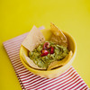 bowl of guacamole and tortilla chips