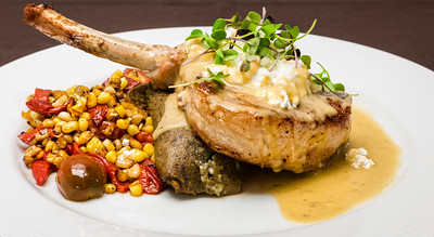 Slagel Farm Pork Chop- Goat Cheese Tamale,, Charred Tomatillo Demi, Cranberry Beans