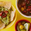 bowls of tortilla chips, salsa,  and guacamole