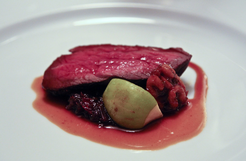 Roast loin of venison with braised red cabbage, pickled walnuts and figs