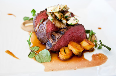 Chargrilled sirloin with sautéed kipfler potatoes, mushrooms, mustard and parsley butter