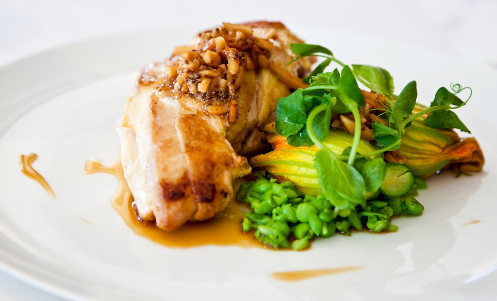 Roasted Glenloth chicken breast with crushed minted peas, ricotta filled zucchini flower and almond dressing