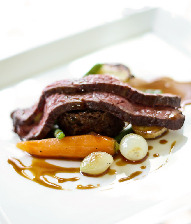 Au Jardin les Amis - Steak and Oxtail  Roasted flank steak and braised oxtail in red wine with seasonal vegetables