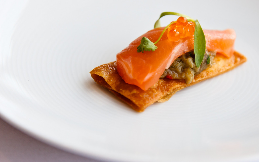 Citrus infused salmon with salmon roe, bed of aubergine and a toasted cracker.