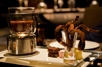Chocolate fondue with marshmallow, brioche, chocolate brownie and chocolate pasta.