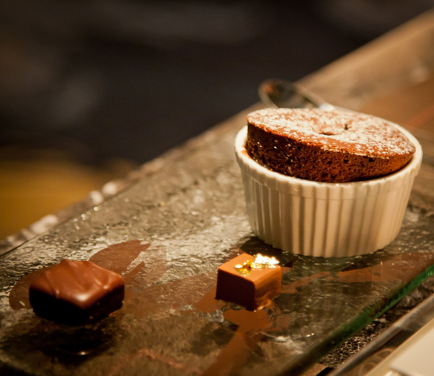 Chocolate souffle with raspberry and chocolate petit fours