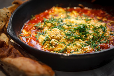 Shakshouka - baked eggs with roasted peppers and shanklish