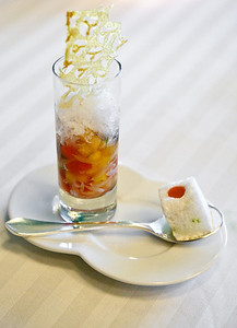 Floating island and diced fruit with a pineapple crisp
