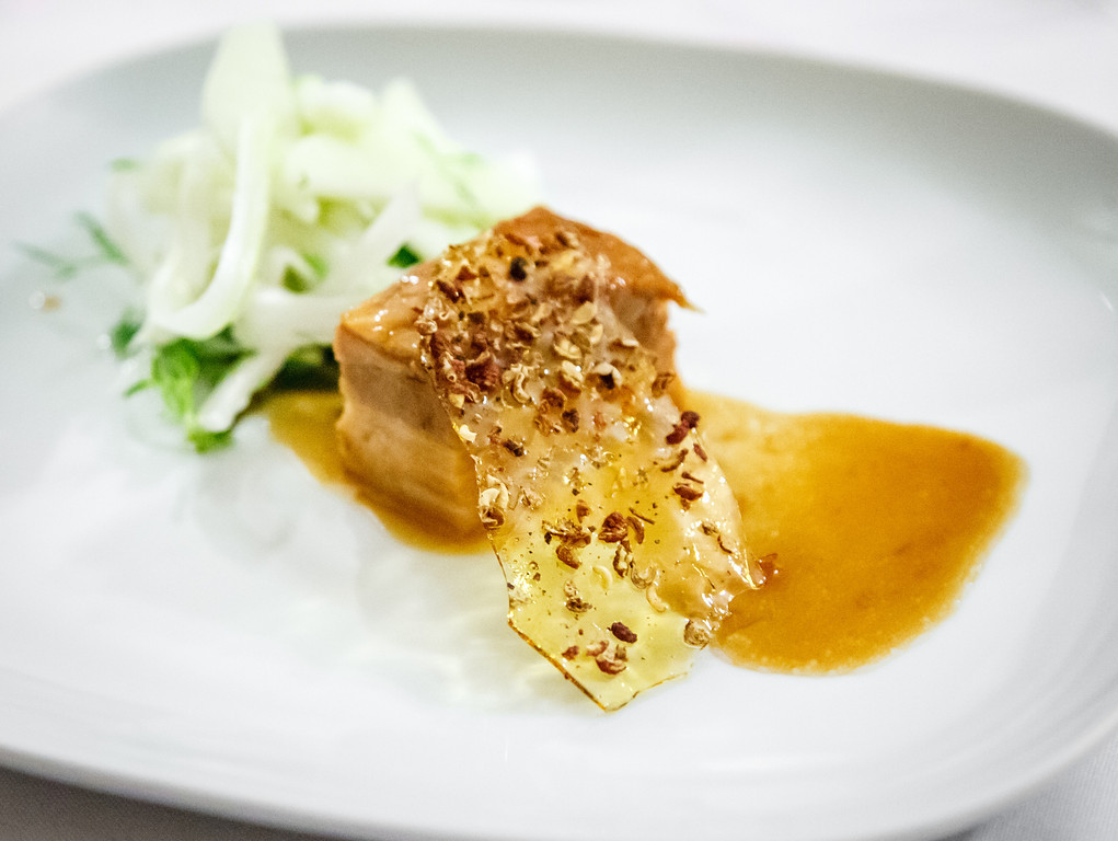 Chinese-style braised pork belly, apple and fennel salad and Szechuan pepper toffee