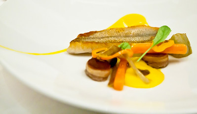 Crispy skin whiting with melanda pork belly, artichokes and olives