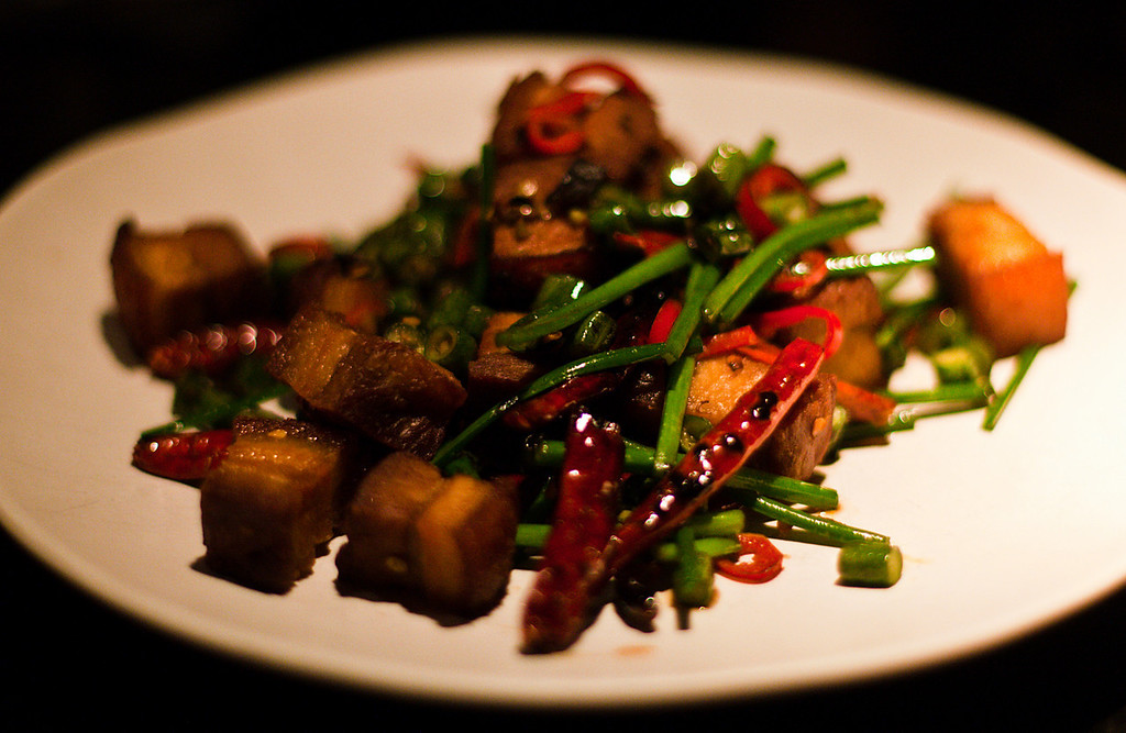 Hunan style crisp pork belly with fresh and dried chillies and mushroom soy