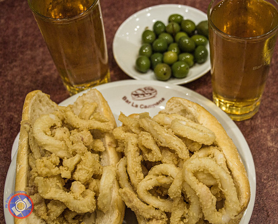 Calamari with Olives and Hard Cider Served at a Favorite Haunt Near Plaza Mayor in Madrid (©simon@myeclecticimages.com)