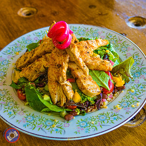Quinoa salad topped with piri-piri chicken