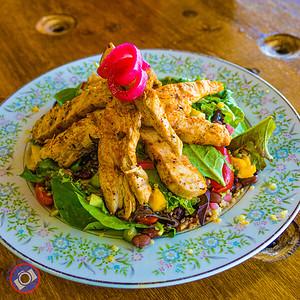 Quinoa salad topped with piri-piri chicken