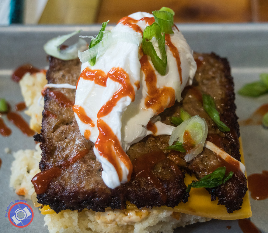 Open-Faced Sausage Biscuit Topped with a Poached Egg (©simon@myeclecticimages.com)