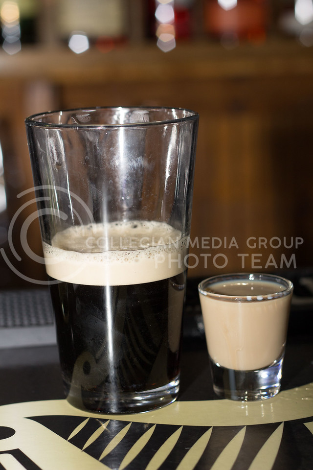 One of O'Malley's most popular drinks the Bellfast is half a pint of guinness with a shot of bradys irish cream, kamrra coffee liqour, and jameson that you drop into the glass of beer then drink. 14 Sept 2017 (Alex Shaw | Collegian Media Group)