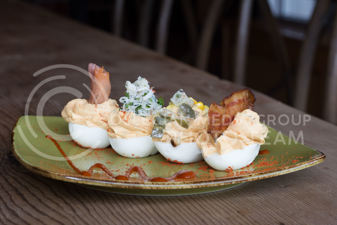 Deviled Eggs Small plate from Burbon and Baker, Pecan bacon, lump crab meat, roasted corn-pickle relish, smoked salmon, capers, smoked paprika, and srircha all artfully combined and presented on a small green plate. 14 Sept 2017 (Alex Shaw | Collegian Media Group)
