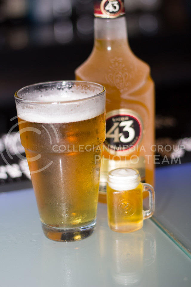 The mini beer shot from Wahoo Fire and Ice pictured next to a full glass of beer and the liquor thats is in the drink. 14 Sept 2017 (Alex Shaw | Collegian Media Group)