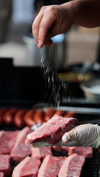 Nadav Soroker/Times-Georgian<br /> <br /> Victor Herrera, Samba Loca's chef, salts meat before grilling at Taste of Carrollton at Adamson Square, on Thursday, September 13, 2018.