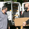 Rick Voutour the director if the Veterans Services in Leominster, on left, and Congressman James McGovern helped distribute boxes of food to those in need on Friday at Doyle Field in Leominster. SENTINEL & ENTERPRISE/JOHN LOVE