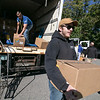 Mike Longley Jr. with Longley Trucking & Excavation out of Fitchburg helped distribute boxes of food to those in need on Friday at Doyle Field in Leominster. The company was the one that donated the truck to help get all the boxes of food to the food distribution event. SENTINEL & ENTERPRISE/JOHN LOVE
