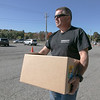 Mike Longley Sr. with Longley Trucking & Excavation helped distribute boxes of food to those in need on Friday at Doyle Field. His company donated the truck to help get the boxes of food to the distribution site. SENTINEL & ENTERPRISE/JOHN LOVE