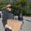 Mike Longley Jr. with Longley Trucking & Excavation out of Fitchburg helped distribute boxes of food to those in need on Friday at Doyle Field in Leominster. The company was the one that donated the truck to help get all the boxes of food to the food distribution site. SENTINEL & ENTERPRISE/JOHN LOVE