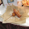 Deep-fried pineapple upside-down cake on a stick.