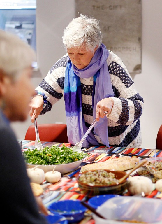 . Maryjane Fromm tosses a kale and butternut squash salad she made for the Stockbridge Library\'s cookbook club. The club brings together local food lovers and makers to share the food they made from recipes found in a different cookbook monthly from the library\'s collection. Thursday, October 6, 2016. Stephanie Zollshan �The Berkshire Eagle | photos.berkshireeagle.com