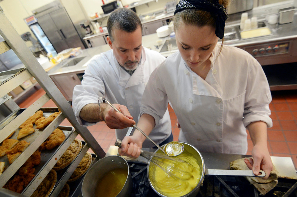. Kate Proudy, of Taconic High School, makes a Hollandaise sauce with teacher Rick Penna, Wednesday Feb. 26, 2014.  Photo by Ben Garver / Berkshire Eagle Staff