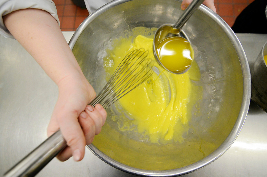 . Kate Proudy, of Taconic High School, makes a Hollandaise sauce, Wednesday Feb. 26, 2014.  Photo by Ben Garver / Berkshire Eagle Staff