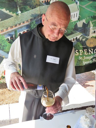 "Father Isaac (Keeley) pours a sample of Spencer Monks' Reserve Ale, a classic Trappist Quadruple (""Quad"") brewed in Spencer, Mass., with American ingredients in the Belgian tradition."