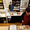 BEN GARVER — THE BERKSHIRE EAGLE<br /> Michael Albin waits for a cheese order at Rubiner's Cheesemongers in Great Barrington.