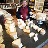 BEN GARVER — THE BERKSHIRE EAGLE<br /> Matt Rubiner sets up shop on Tuesday, May 30, 2017.  The shop feature an ever changing array of artisinal cheeses.