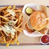 BEN GARVER — THE BERKSHIRE EAGLE<br /> A Box Burger with Parmesan fries  is served hot off the grill to a customer at the Bistro box. The burger features tomato and bacon jam.