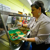 KRISTOPHER RADDER — BRATTLEBORO REFORMER<br /> Brattleboro Town Food Service Director Ali West, of Fresh Picks Cafe, plates a Tibetan meal for students at Academy School, in Brattleboro, on Tuesday, Jan. 7, 2020.