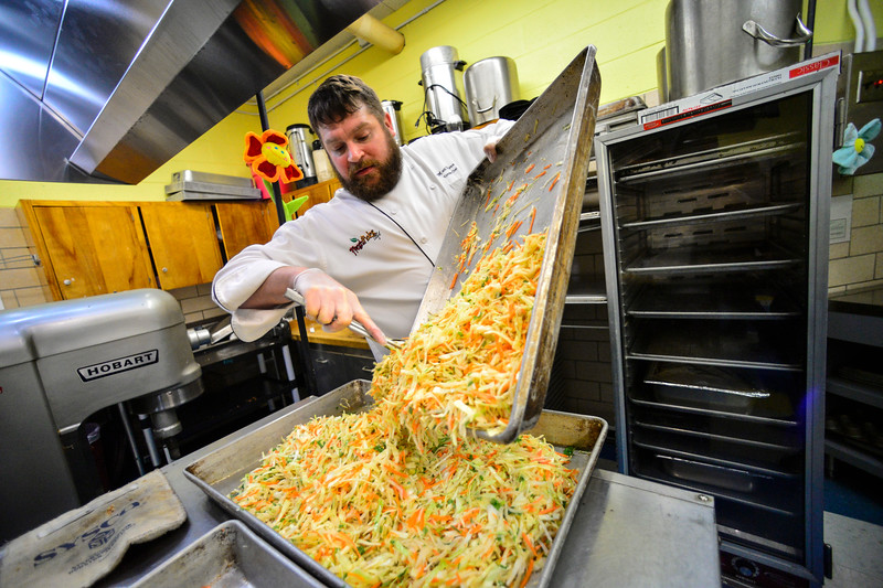 KRISTOPHER RADDER — BRATTLEBORO REFORMER<br /> Matthew Pierce, executive chef at Fresh Picks Cafe, and a team of people help make a Tibetan meal for students at Academy School, in Brattleboro, on Tuesday, Jan. 7, 2020.
