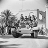 A piper of the Gordon Highlanders plays from a Valentine tank as it drives into Tripoli past crowds of cheering locals, 26 January 1943.E 21592Part ofWAR OFFICE SECOND WORLD WAR OFFICIAL COLLECTIONDrennan (Sgt)No 1 Army Film & Photographic Unit