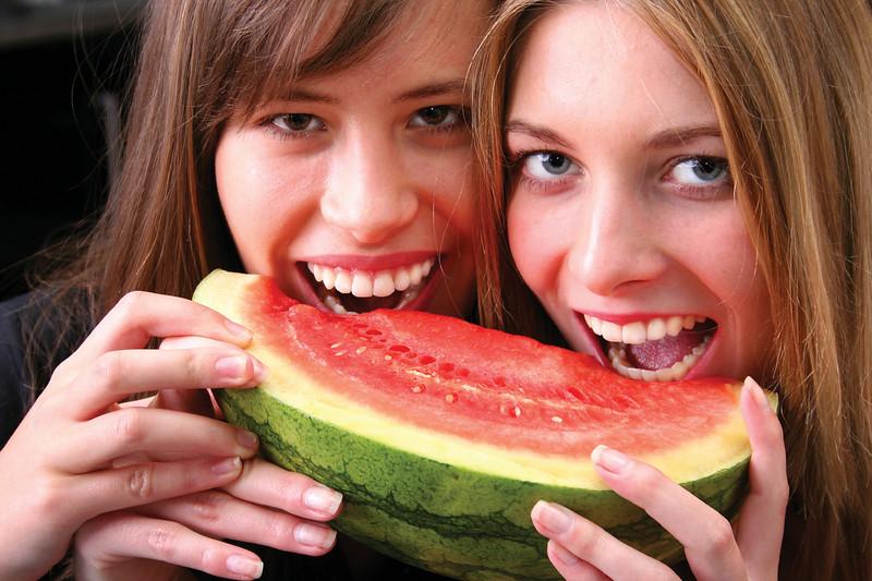 Young girls enjoying a fruit